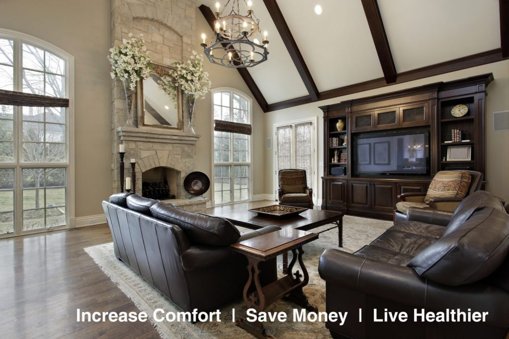 Family room in luxury home with two story stone fireplace